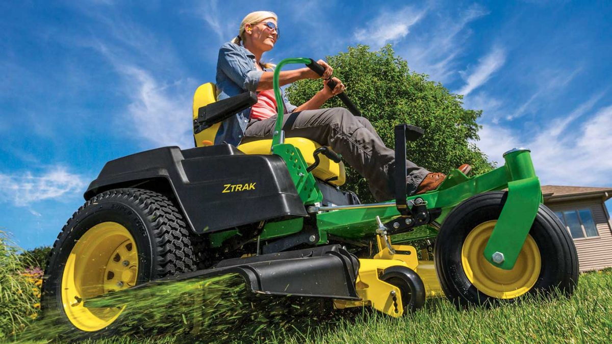 woman on ztrack mower